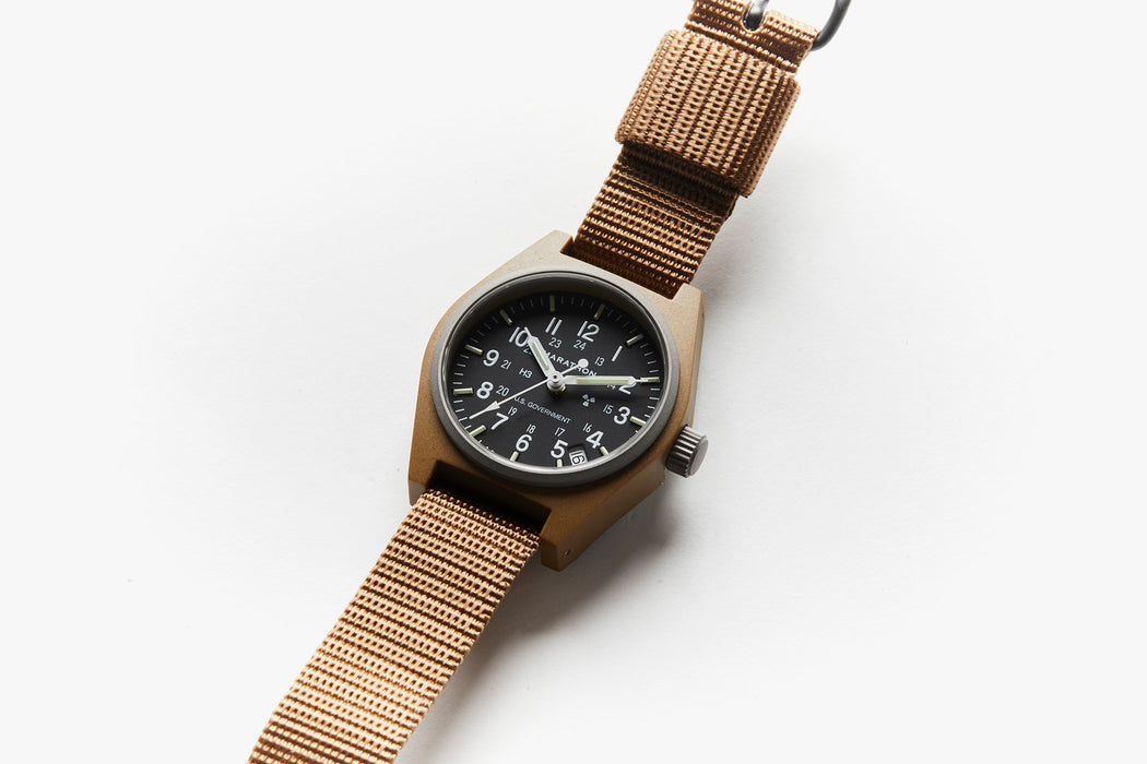 Marathon General Purpose Quartz Composite Watch With Date - Desert Tan - Side view of watch laying flat
