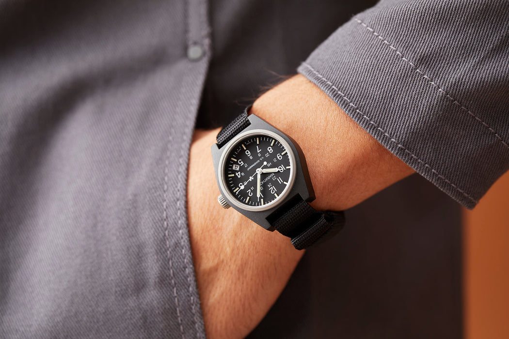 Marathon General Purpose Quartz Composite Watch With Date - Black - Man wearing watch with one hand in his pocket