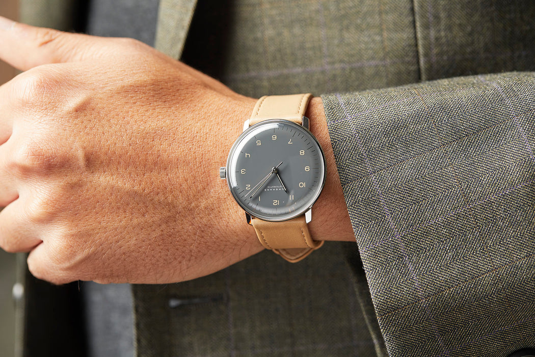 Junghans Max Bill Automatic Watch - man wearing watch, showing option with gray dial and brown leather strap