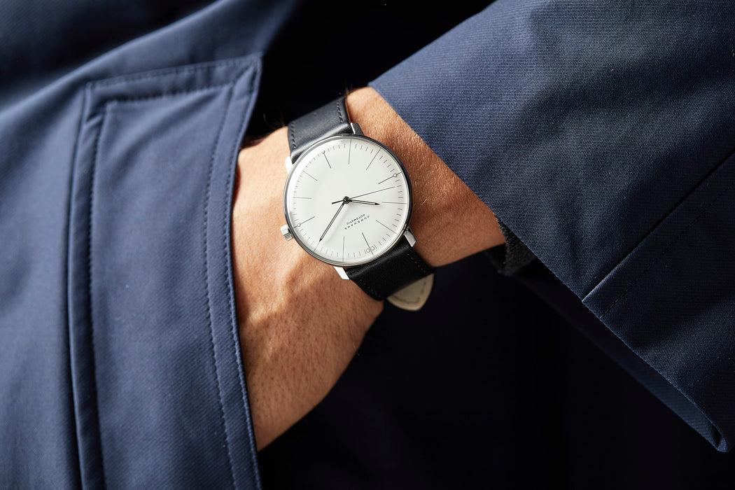Junghans Max Bill Automatic Watch - man wearing watch, showing option with white dial and black leather strap