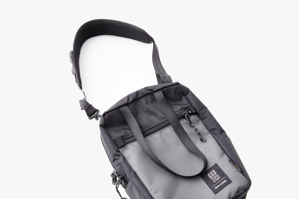 Black/Grey - Topo Designs x Gear Patrol Backpack Tote - Laying flat with shoulder strap handle out.