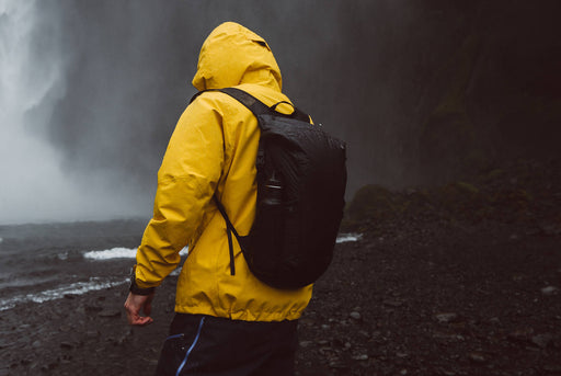 Matador Freerain24 2.0 Backpack - Black - Man wearing pack as he walks in the rain