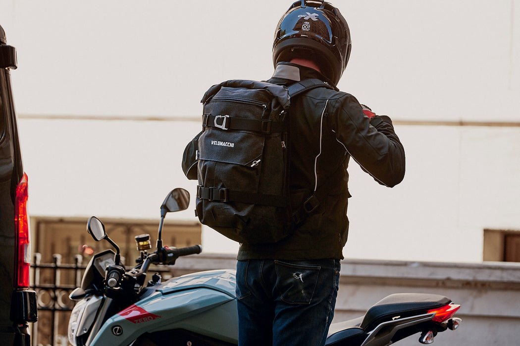 Velomacchi Speedway 40L Backpack - Person wearing getting on motorcycle