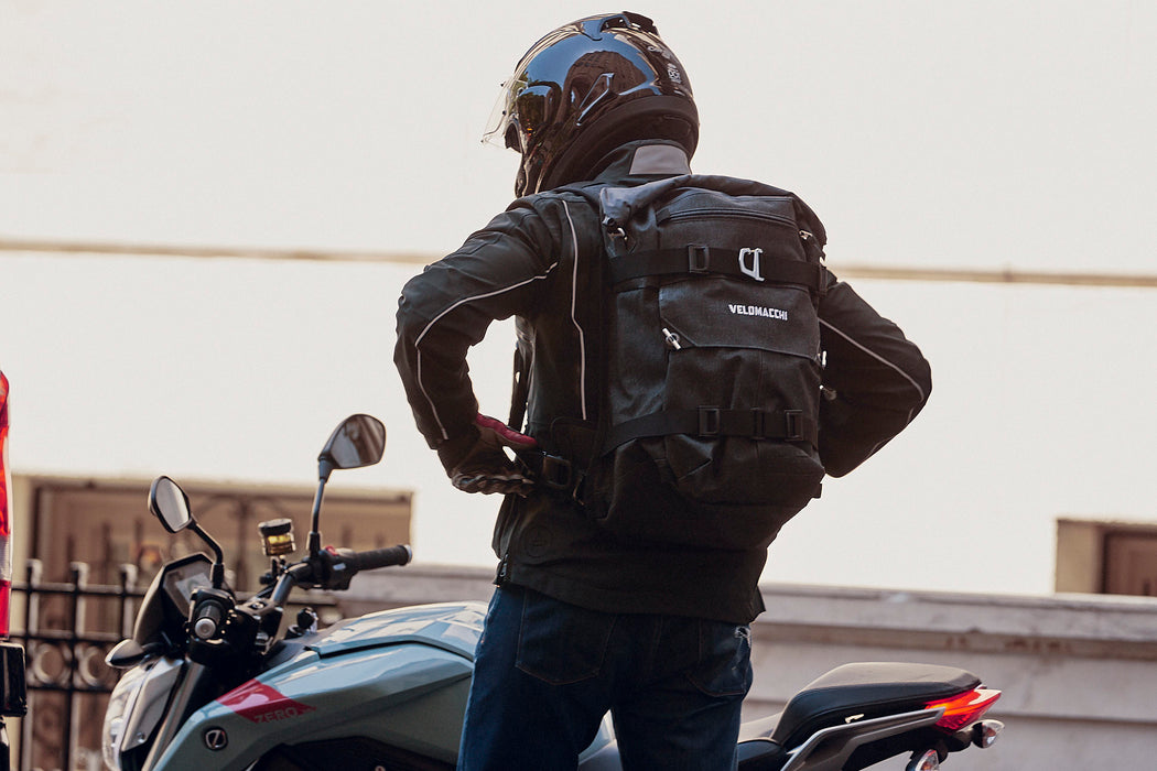 Velomacchi Speedway 40L Backpack - On person getting on motorcyle