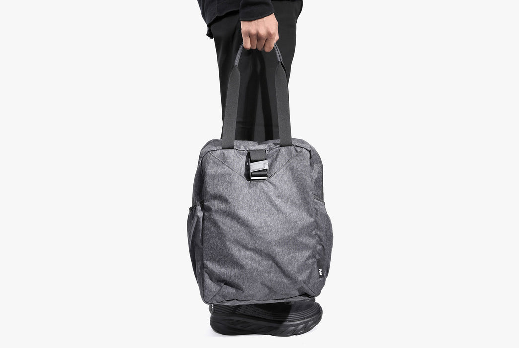 Gray Go Tote On Model - In Hand - Side View