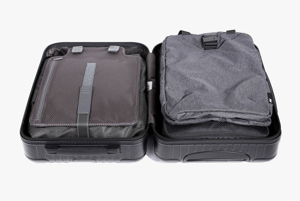 Gray Go Tote Laid Flat in Suitcase