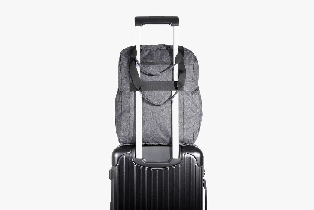 Gray Go Tote Attached to Suitcase via Luggage Strap