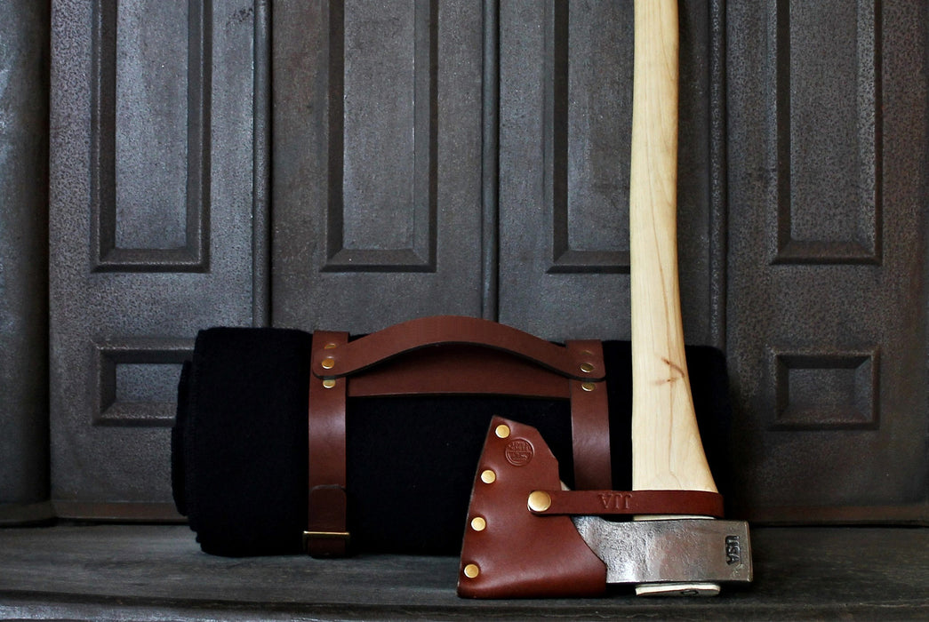 Navy Blanket - Rolled Up with Leather Carrying Strap - Side View Pictured with Axe