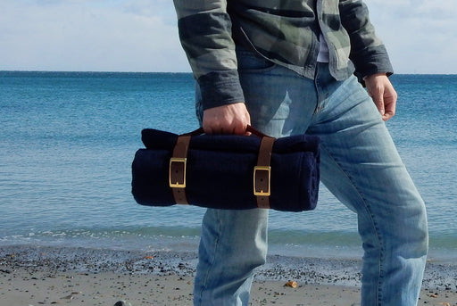 Navy Blanket - Rolled Up with Leather Carrying Strap - In Model's Hand
