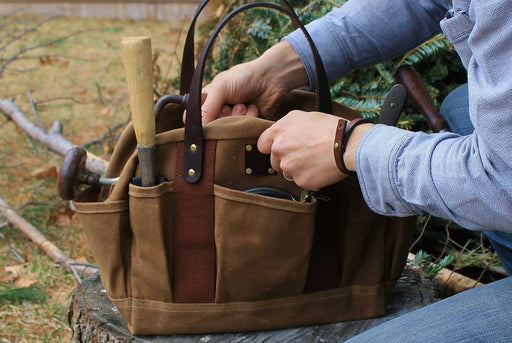Brown Zippered Tool Tote Standing Up - Lifestyle Image of Man Pulling Tools out of Bag
