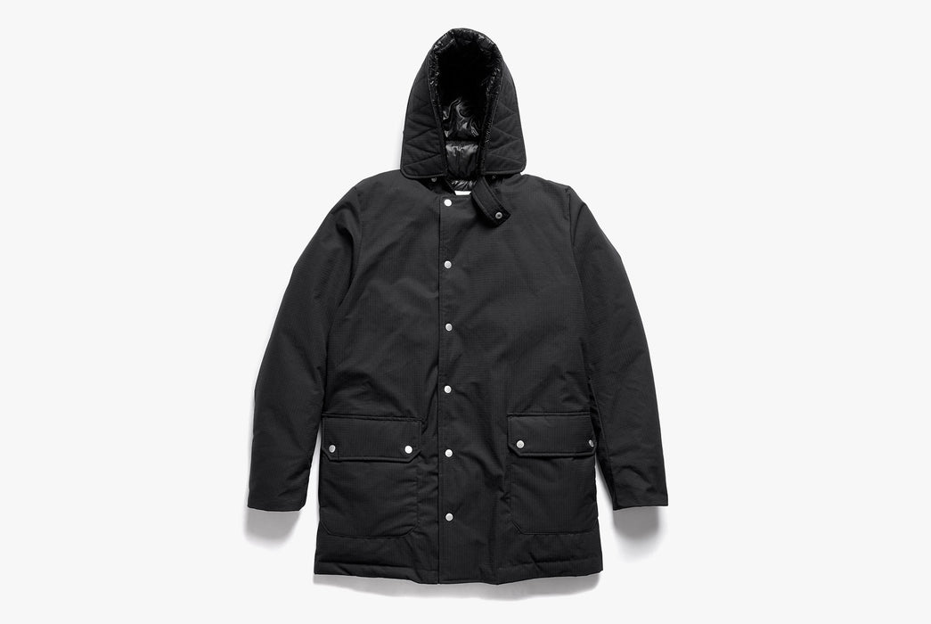 Black American Trench x Gear Patrol Parka - front view showing buttons and hood up on white background