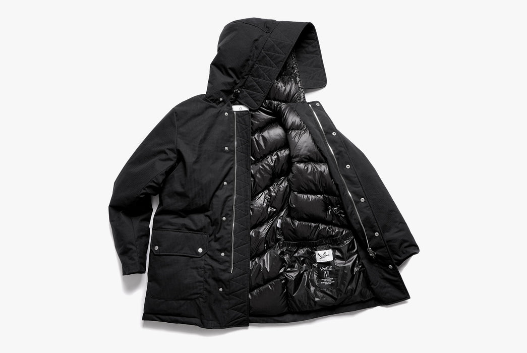Black American Trench x Gear Patrol Parka - side view showing open parka, shiny interior, and label on a white background