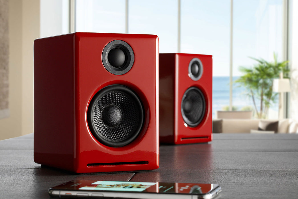 Red Speakers Standing Up on Table - Front View