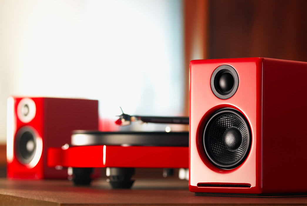 Red Speakers Standing Up Beside Turntable - Front View