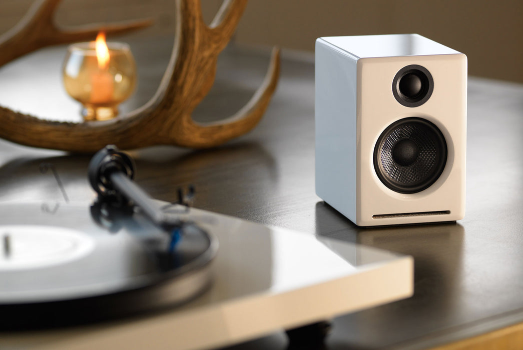 White Speaker Standing Up on Table - Front View
