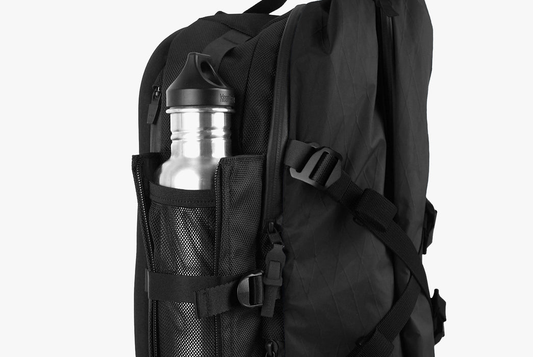 Black Sling Pack - Standing Up - Side View with Water Bottle Holster