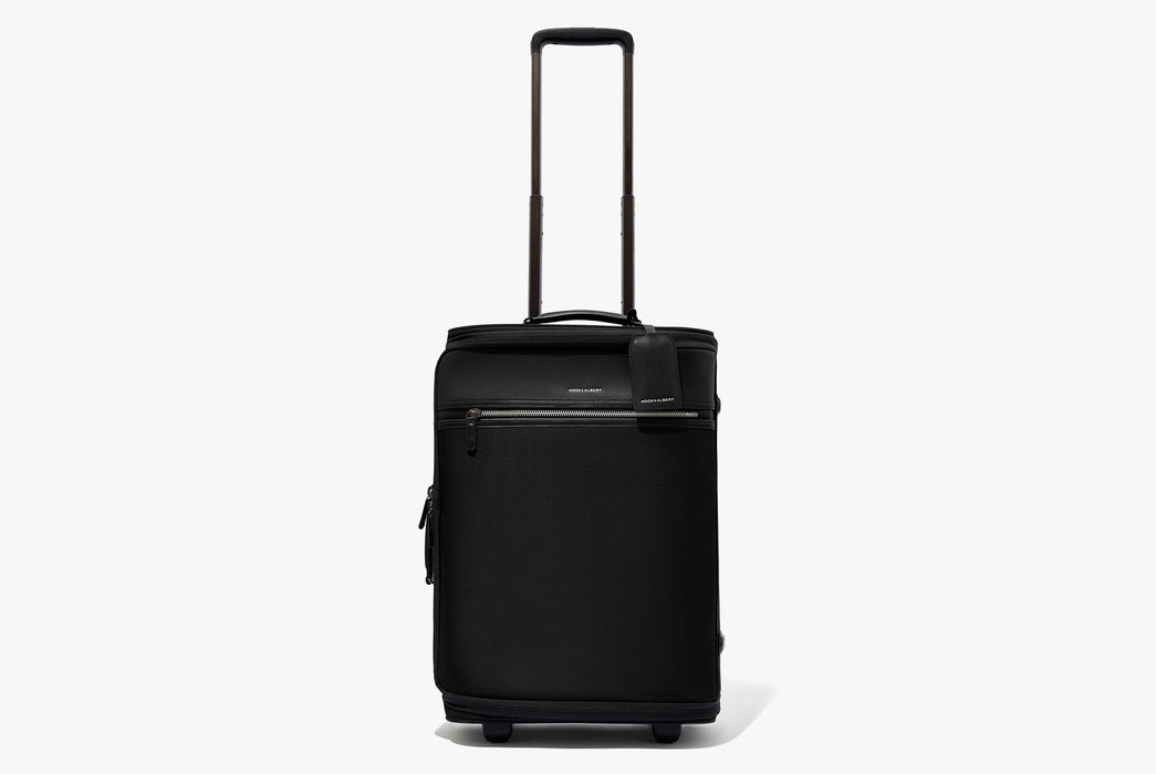 Hook & Albert Garment Luggage Carry-On Bag - bag standing up on wheels with handle fully extended