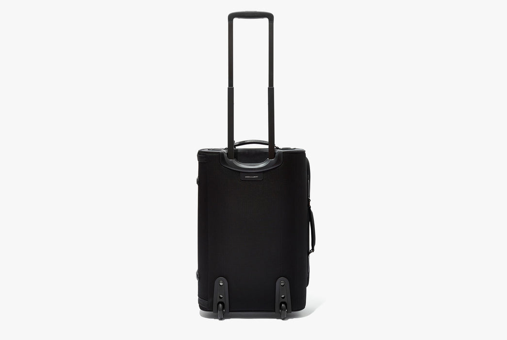 Hook & Albert Garment Luggage Carry-On Bag - bag backwards, standing up on wheels with handle fully extended