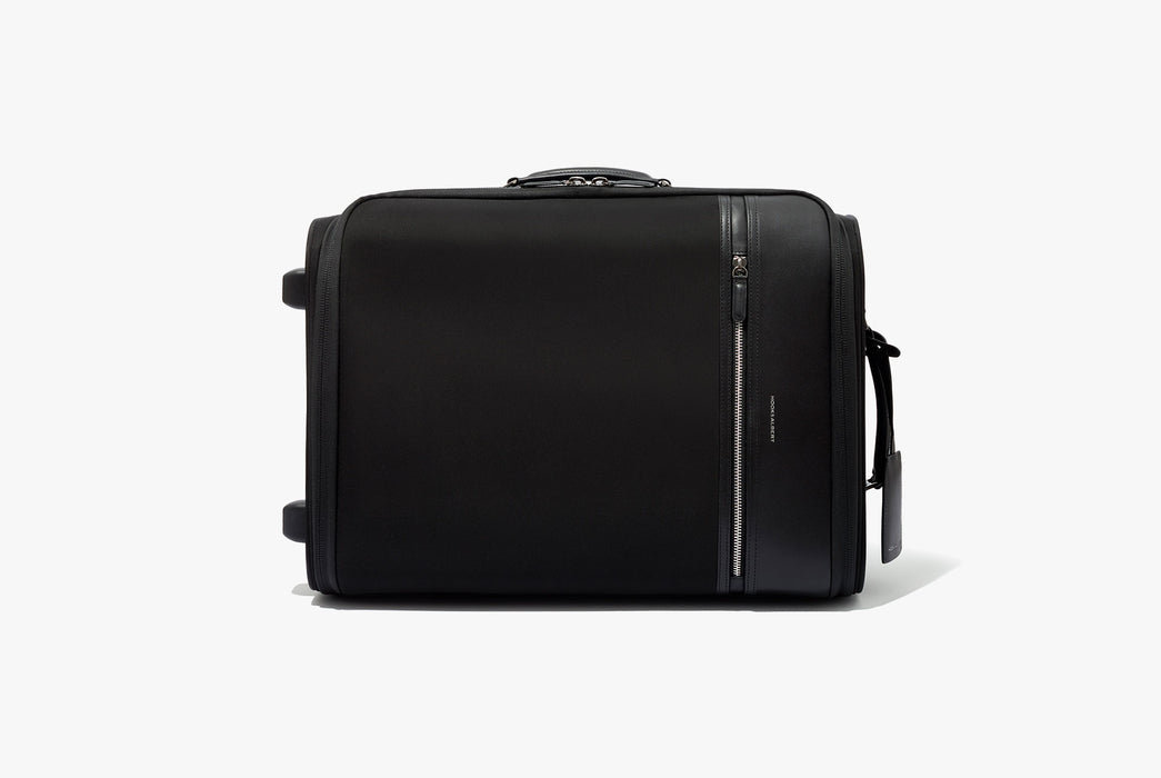 Hook & Albert Garment Luggage Carry-On Bag - bag laying on its side showing side handle detail