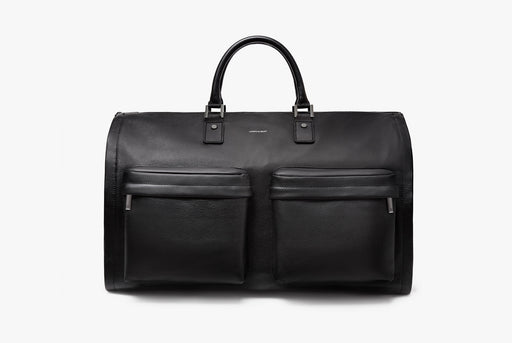 Hook & Albert Black Leather Garment Weekender Bag - bag standing up with handles up, showing two zippered compartments