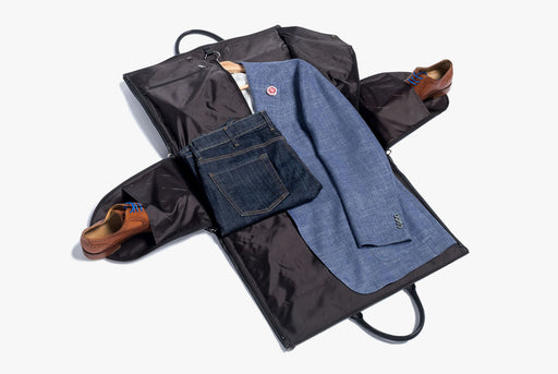 Hook & Albert Black Leather Garment Weekender Bag - unzipped, showing a suit jacket, folded jeans, and two shoes inside shoe compartments