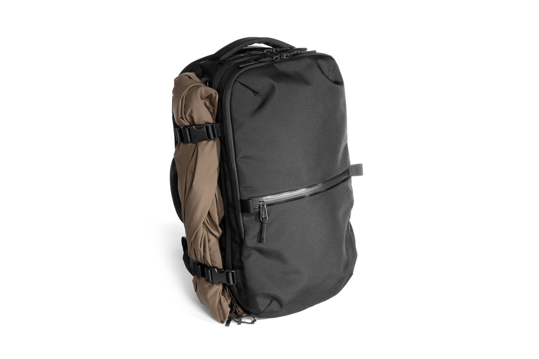 Black Travel Pack Standing Up - Front View with Accessory Clips
