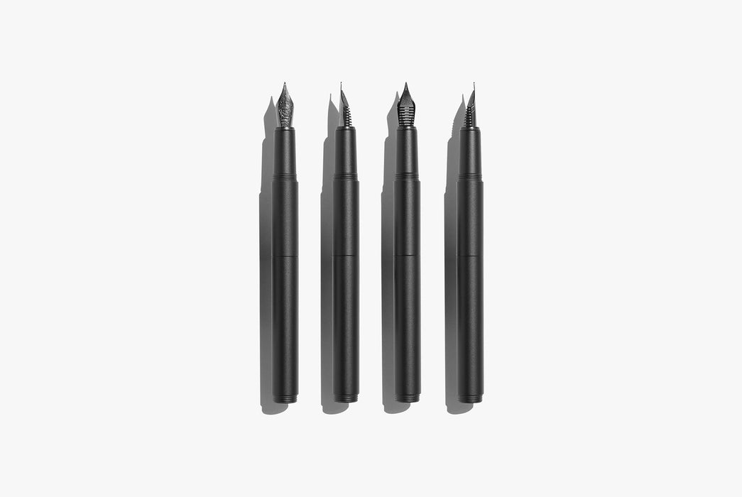 Inventery Pocket Fountain Pen With Extender - Black - four fountain pens next to each other