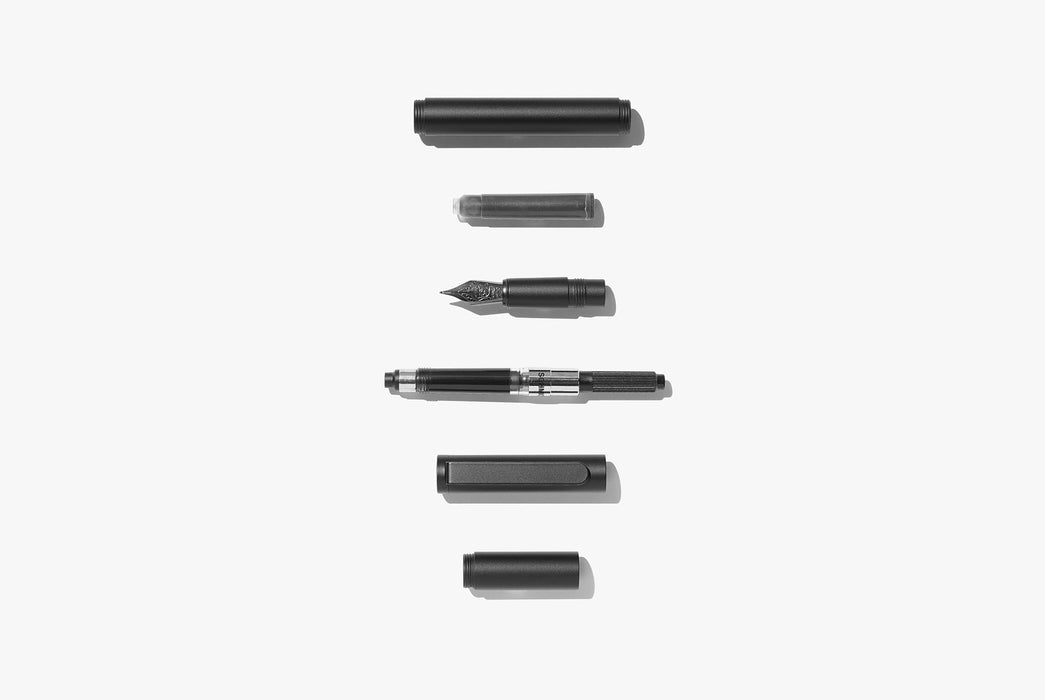 Inventery Pocket Fountain Pen With Extender - Black - deconstructed pieces of fountain pen laying in a vertical line