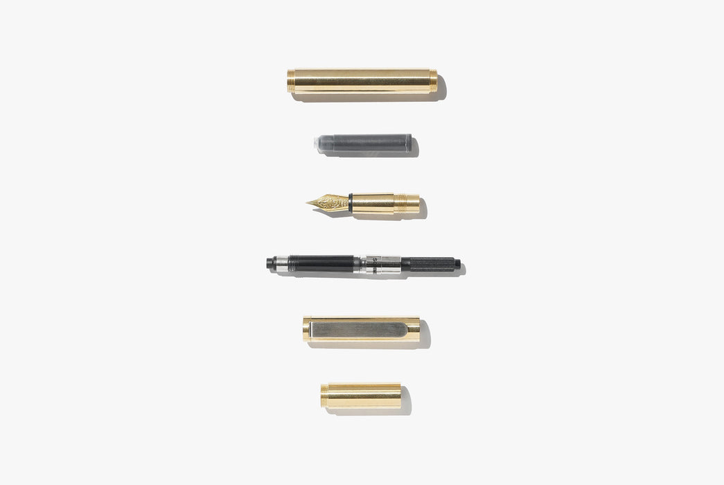 Inventery Pocket Fountain Pen With Extender - Brass - deconstructed fountain pen parts laying in a vertical line
