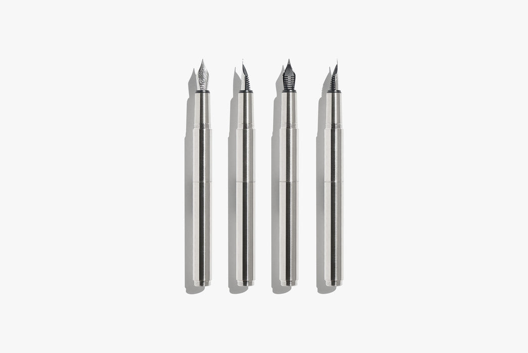 Inventery Pocket Fountain Pen With Extender - Chrome - four silver-toned fountain pens laying side by side