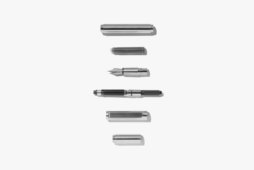 Inventery Pocket Fountain Pen With Extender - Chrome - deconstructed pieces of silver-toned fountain pen laying next in a vertical line