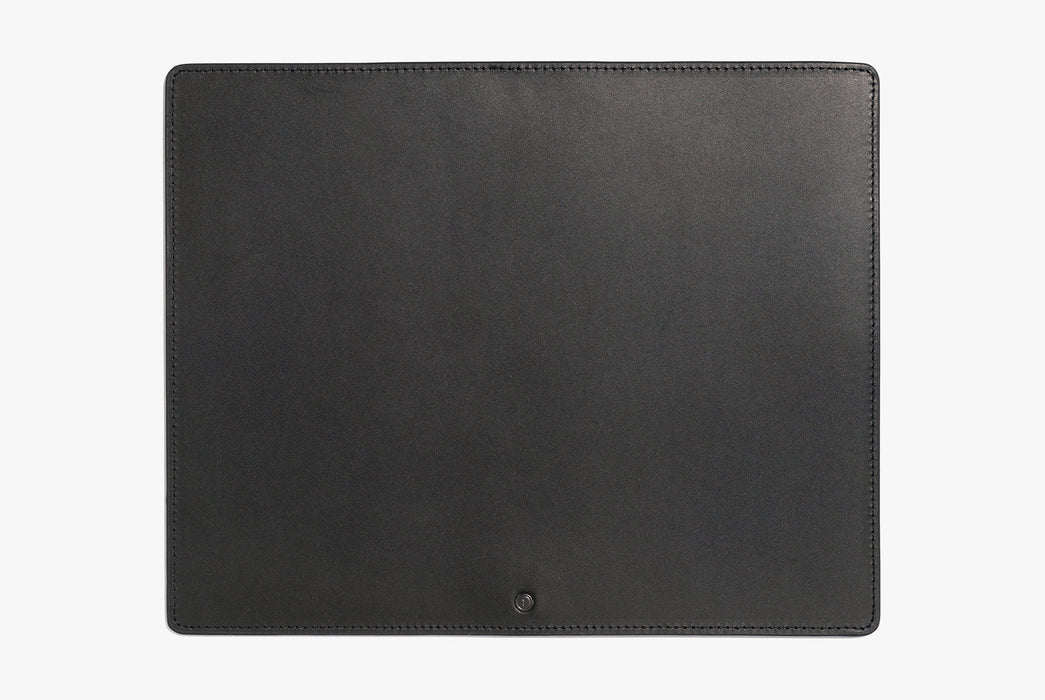 Black Inventery Leather Mouse Pad - top-down shot showing a small black stud