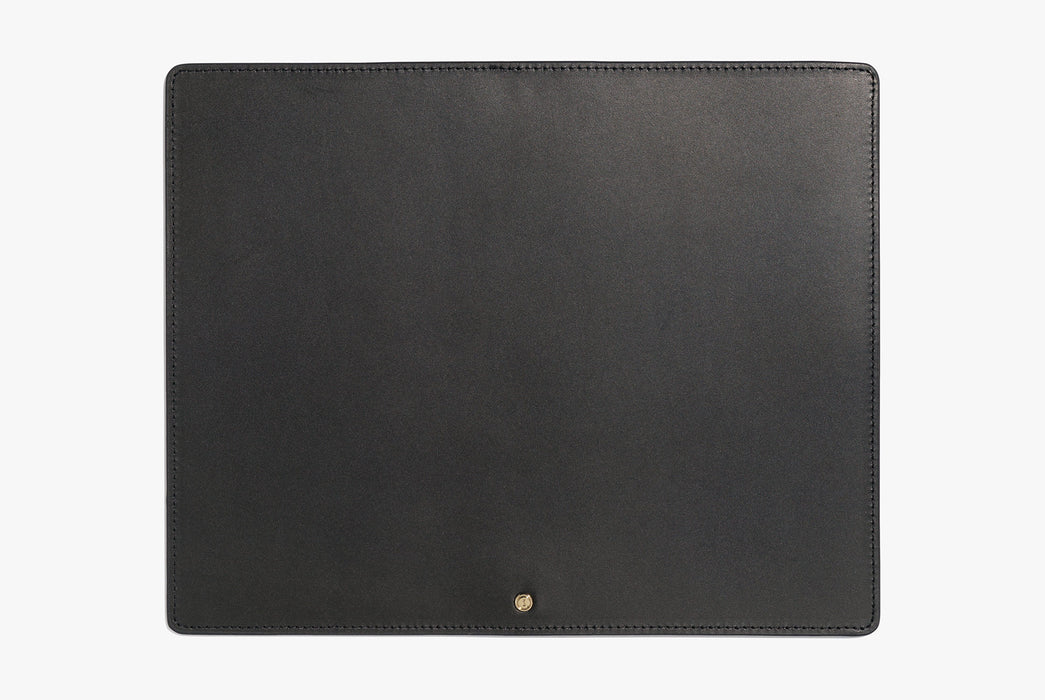 Black Inventery Leather Mouse Pad - top-down shot showing a small gold stud