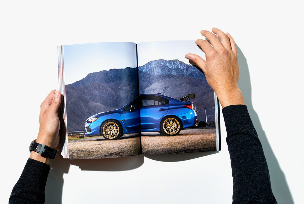 Gear Patrol Magazine, Issue Eight - Open to Spread showing blue car in front of mountains