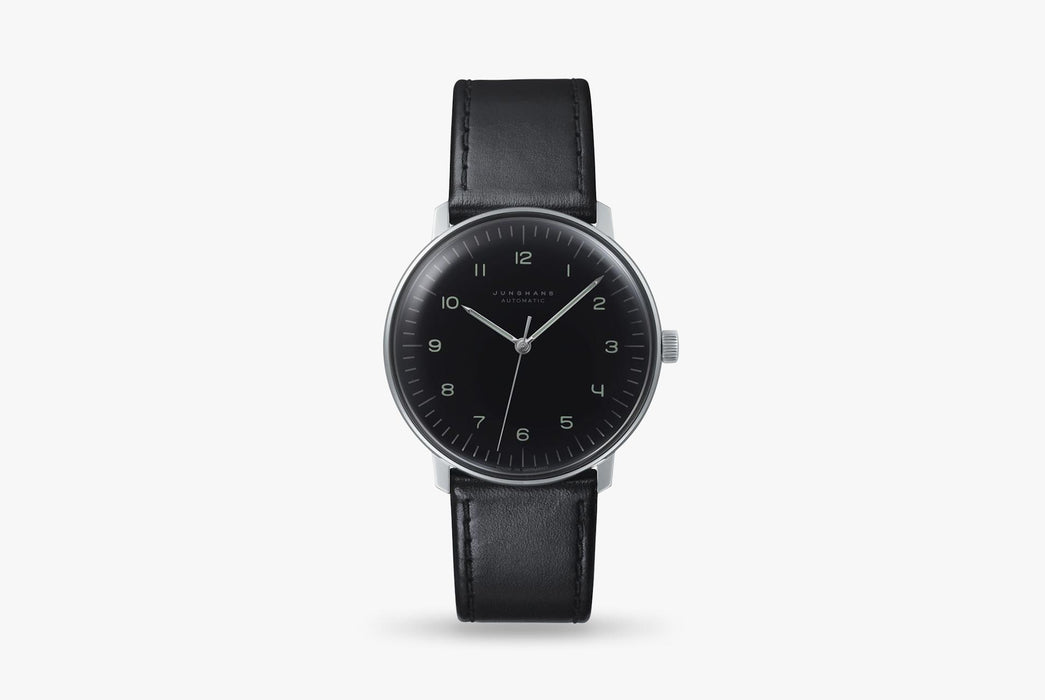 Junghans Max Bill Automatic Watch - watch standing up, showing option with black dial and black leather strap