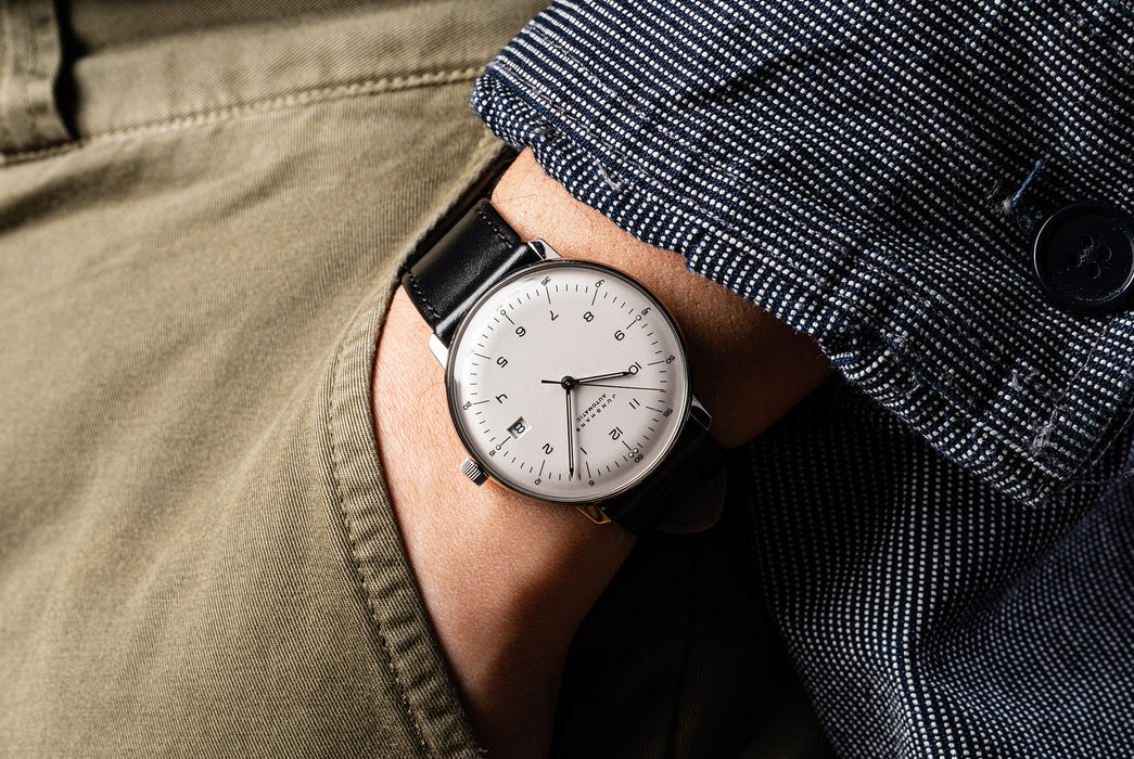Junghans Max Bill Automatic Date Watch - man wearing the watch with a white dial and a black leather strap