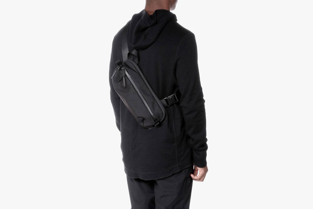 Black Sling Bag - On Model - Worn Over the Shoulder