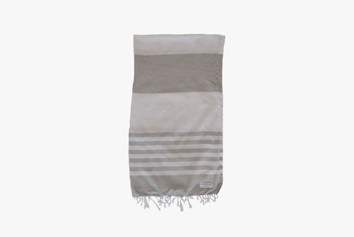 Long Wharf Supply Co. Chatham Travel Towel - Grey - image of towel folded vertically, showing gray and white stripes and fringe detailing at bottom