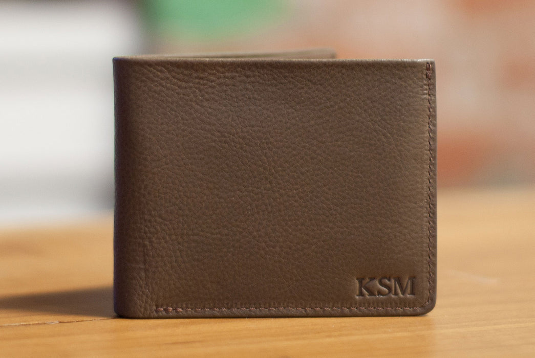 Lotuff Leather Bifold Wallet - image of leather wallet and debossed letter detailing