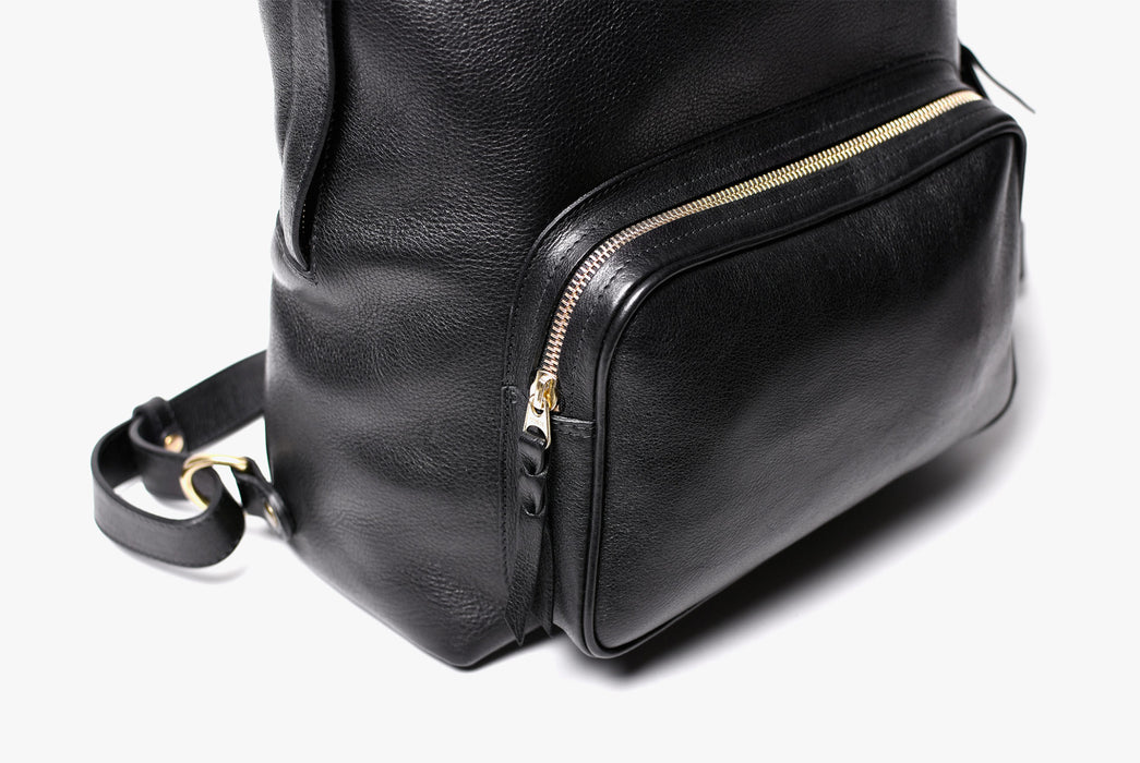 Lotuff Zipper Backpack - Black - close-up of front zipper pocket