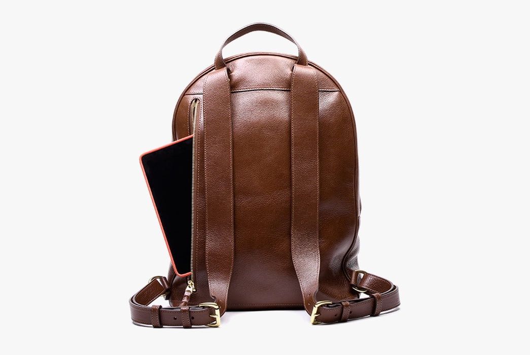 Lotuff Zipper Backpack - Chestnut - back view of bag and straps and an iPad poking out of the back zipper pocket