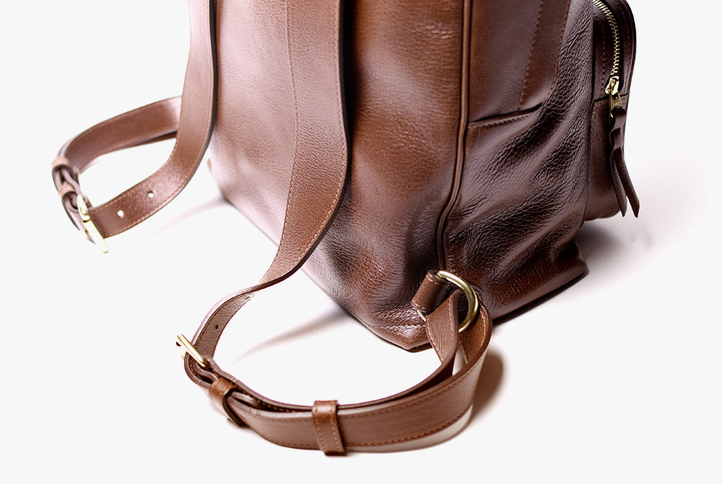 Lotuff Zipper Backpack - Chestnut - close up of gold metal detailing on straps