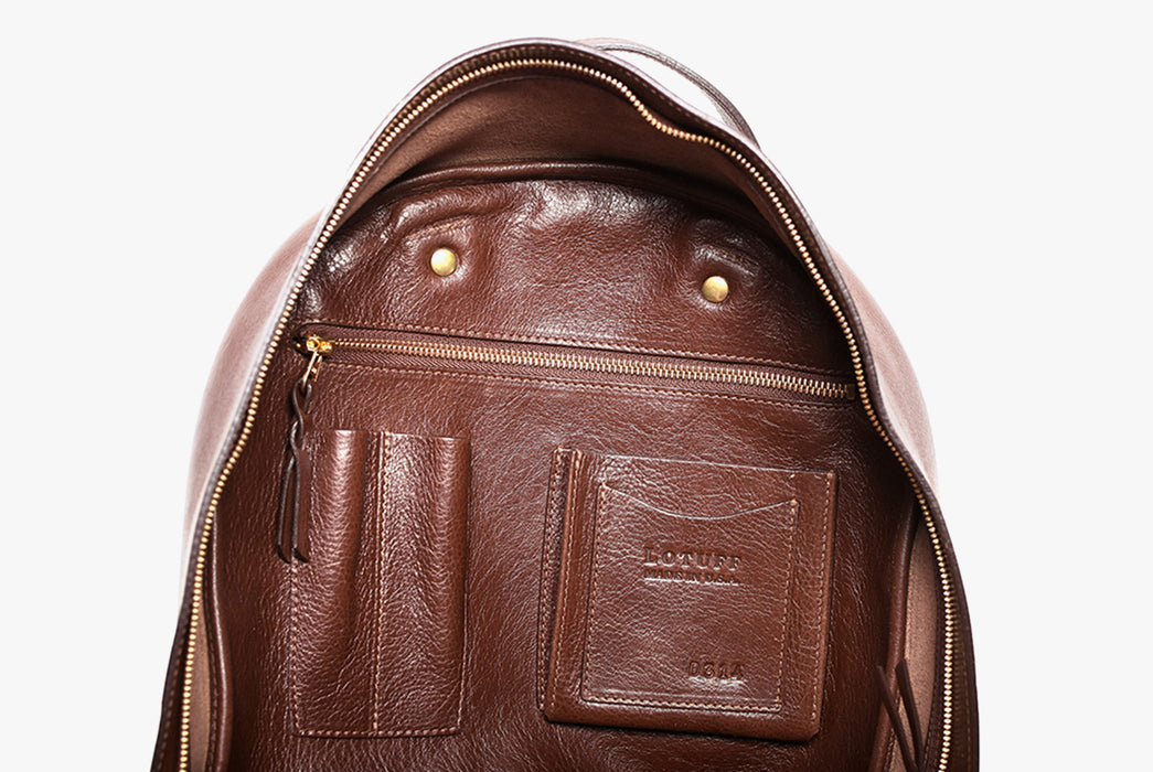 Lotuff Zipper Backpack - Chestnut - close-up view of internal pockets, pen holders and a zipper pocket