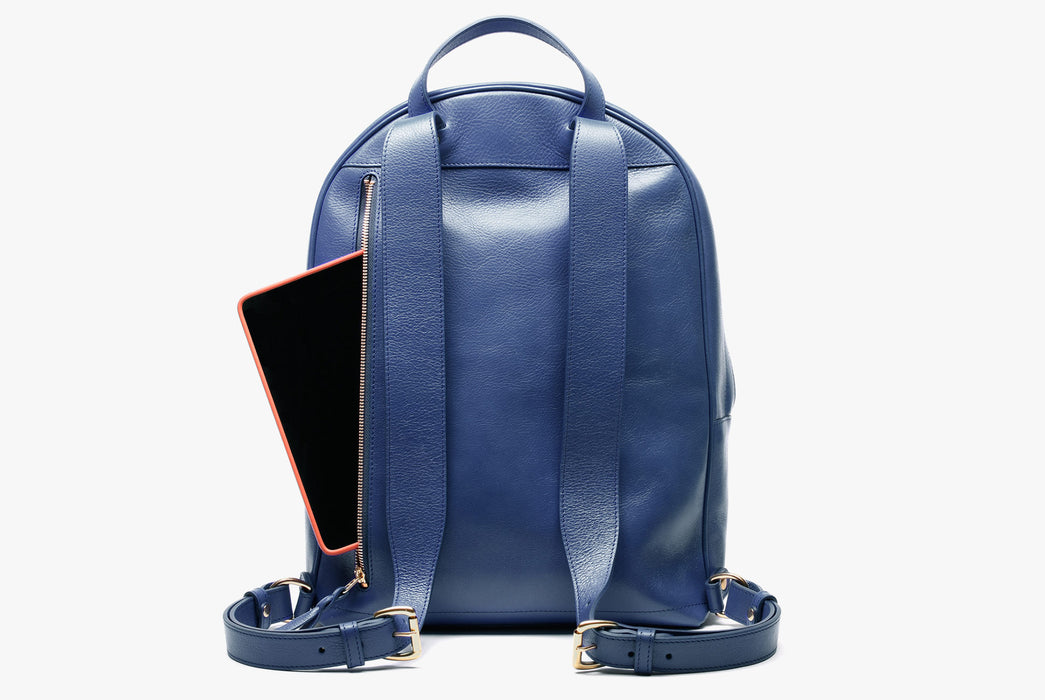 Lotuff Zipper Backpack - Blue - back view of bag standing upright showing an iPad poking out of the back zipper pocket