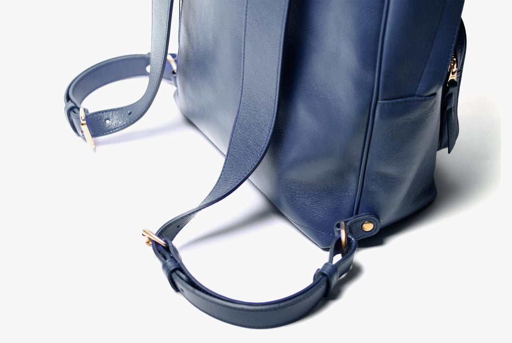 Lotuff Zipper Backpack - Blue - close-up of gold hardware on shoulder straps