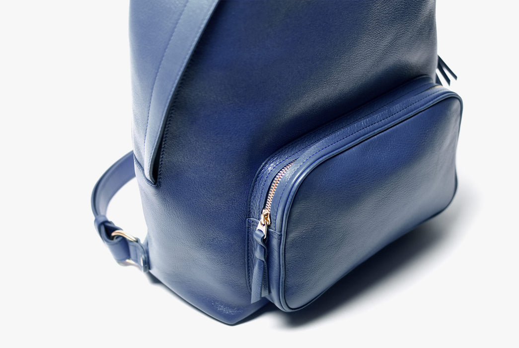 Lotuff Zipper Backpack - Blue - close-up of front zipper pocket