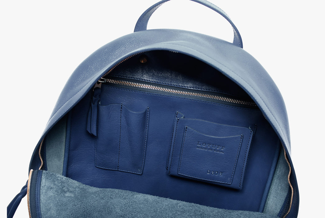 Lotuff Zipper Backpack - Blue - close-up of interior pockets, including pen holders and a zipper pocket