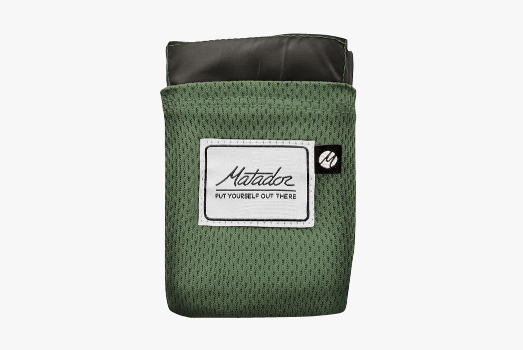 Matador Packable Pocket Blanket - Green - Front view of folded-up blanket in case
