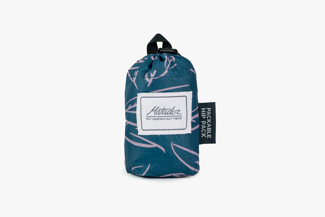 Matador Packable Hip Bag - Leaf - Pack rolled up into compact carrying case