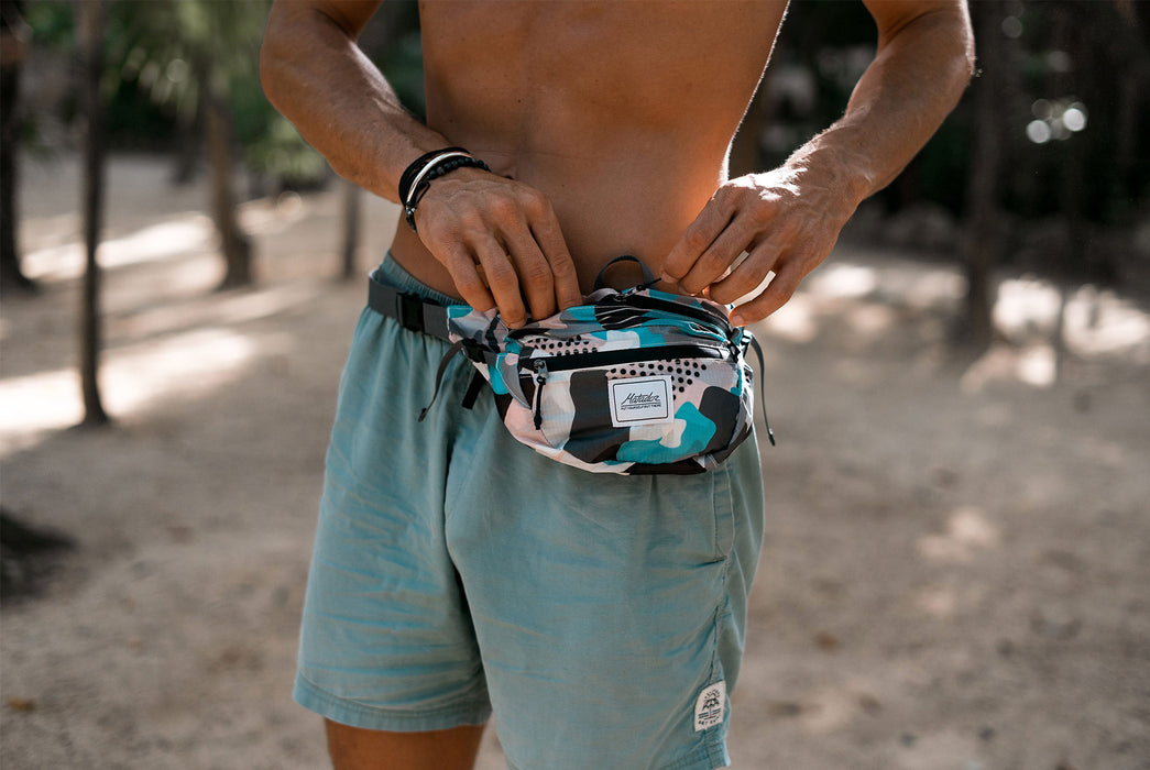 Matador Packable Hip Bag - Front view of a pack with pink, turquoise, and black shapes and patterns